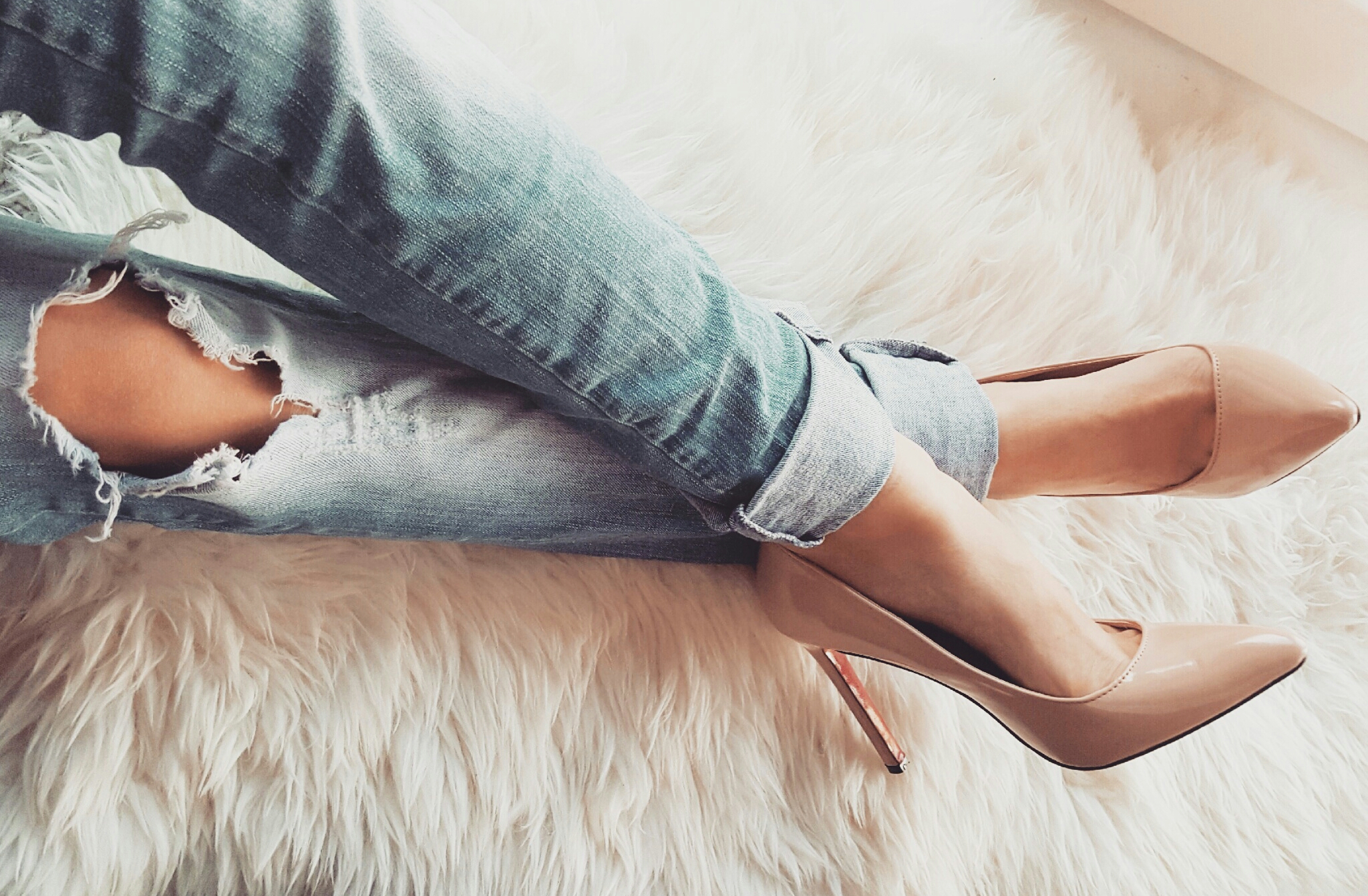 Ripped jeans and nude heels